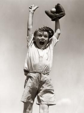 Excited Smiling Boy, Arms Raised by H. Armstrong Roberts
