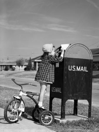 Girl Standing on Tricycle on Suburban Sidewalk, Mailing Letter in Mailbox by H. Armstrong Roberts