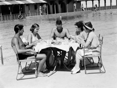 Group of People Sitting Poolside at Hotel, Eating Dinner, Miami, Florida by H. Armstrong Roberts