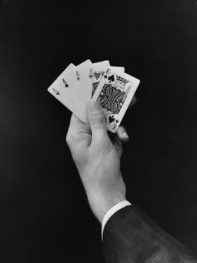 Man's Hand Holding 'Full House' Poker Card Hand by H. Armstrong Roberts