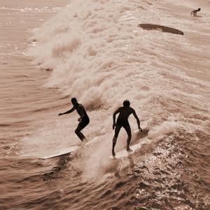 Men Surfing Waves by H. Armstrong Roberts