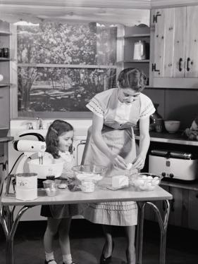 Mother and Daughter at Kitchen Table, Preparing Ingredients in Mixer For Baking by H. Armstrong Roberts