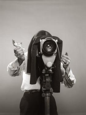 Photographer Behind View Camera Holding a Birdy by H. Armstrong Roberts