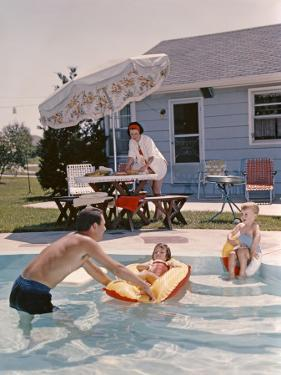 Retro Family in Backyard, Showing an In-Ground Swimming Pool by H. Armstrong Roberts
