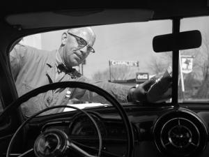 Service Station Attendant in a Bow Tie Washing Customers Windshield by H. Armstrong Roberts