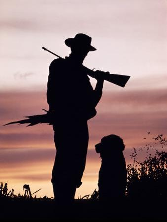 Silhouette of Man Hunter, Holding Rifle or Gun, Wearing Cowboy Hat by H. Armstrong Roberts