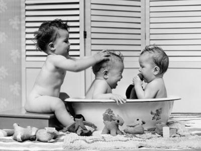 Three Babies in Wash Tub, Bathing by H. Armstrong Roberts