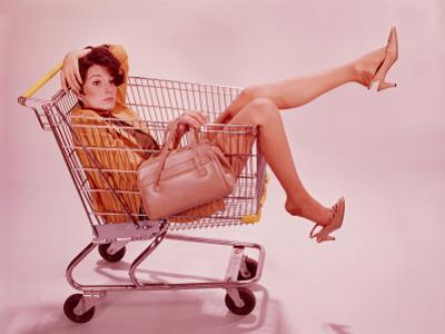 Woman in Supermarket Trolley by H. Armstrong Roberts