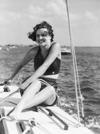 Woman in Swimsuit, on Sailing Boat, Holding Rope, Smiling by H. Armstrong Roberts