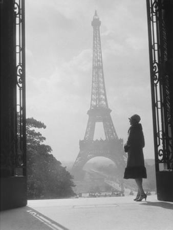 Woman looking toward Eiffel Tower by H. Armstrong Roberts
