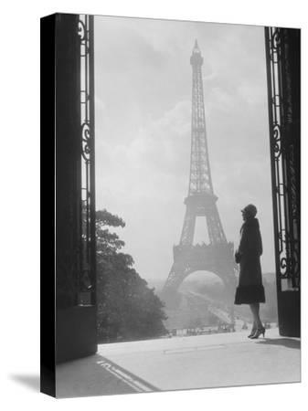 Woman looking toward Eiffel Tower