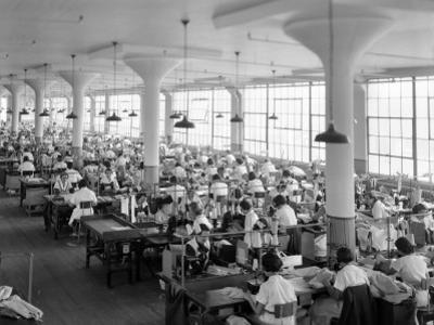 Women in Textile Factory at Sewing Machines by H. Armstrong Roberts