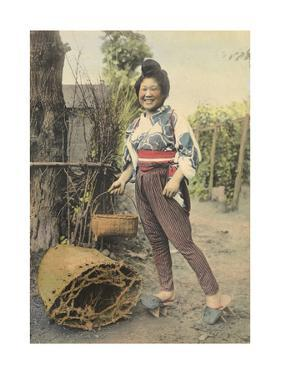 A Japanese Farmer Girl, in Traditional Clothing, Carries a Basket by H.M. Herget