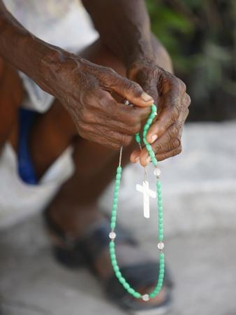 https://imgc.allpostersimages.com/img/posters/haitian-woman-praying-with-prayer-beads-port-au-prince-haiti-west-indies-central-america_u-L-PFNV6D0.jpg?p=0