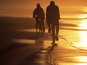 Couple Biking Toward Sunset, Monterey, CA by Hal Gage