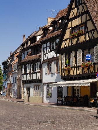 https://imgc.allpostersimages.com/img/posters/half-timbered-buildings-along-the-quai-de-la-poissonnerie-colmar-haut-rhin-alsace-france_u-L-P7X29G0.jpg?p=0