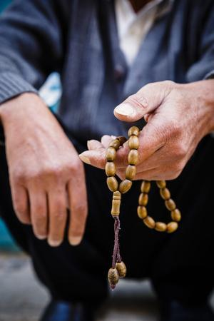https://imgc.allpostersimages.com/img/posters/hands-holding-worry-beads-bethlehem-west-bank-palestine-territories-israel-middle-east_u-L-PWFRIC0.jpg?p=0