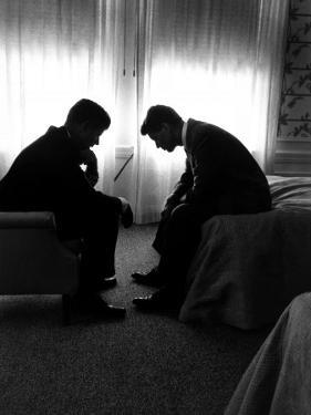 Jack Kennedy Conferring with His Brother and Campaign Organizer Bobby Kennedy in Hotel Suite by Hank Walker
