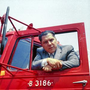 Portrait of Teamsters Union Pres. Jimmy Hoffa Leaning Out Window of Red Truck by Hank Walker