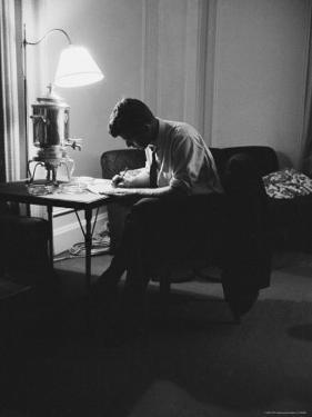 Presidential Candidate John F. Kennedy Makes Last Minute Notes in at Democratic National Convention by Hank Walker