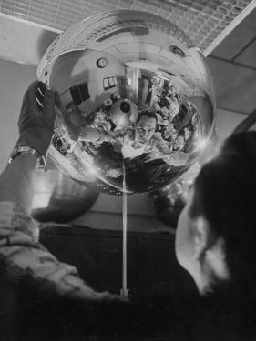 Scientist Alexander Simkovich Working on a Us Artificial Satellite by Hank Walker