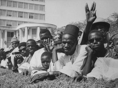 Senegalese Awaiting Arrival of US VP Lyndon Johnson to Celebrate First Year of their Independence by Hank Walker