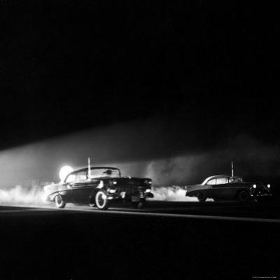 Two Cars in Drag Race by Hank Walker
