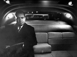 VP Richard Nixon Sitting Solemnly in Back Seat of Dimly Lit Limousine by Hank Walker
