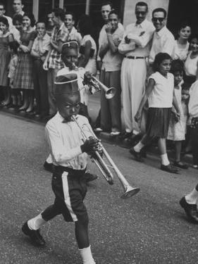 Young Boys Playing Trumpets in a Parade by Hank Walker