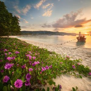 Beautiful Beach with Colorful Flowers and Longtail Boat on the Sea. Thailand by Hanna Slavinska