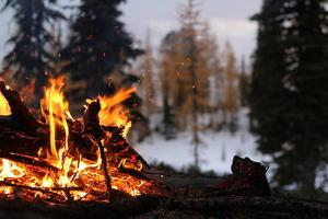 Hiking Boots Dry Out Next To A Campfire In The Wilderness by Hannah Dewey