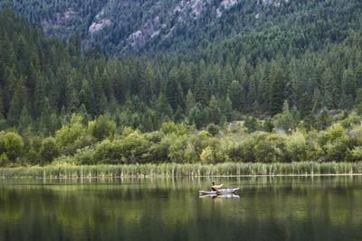 Man Fly-Fishes Out Of His Kayak On Fish Lake Outside Of Conconully, Washington
