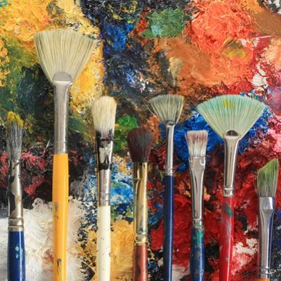 Artist Brushes On An Oil Painting Background by Hannamariah