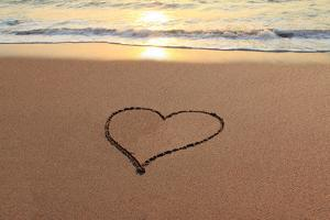 Heart in the Sand on the Beach at Sunset. by Hannamariah