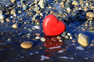 Red Valentine Heart on the Beach by Hannamariah