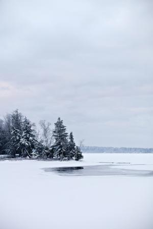 The Ice and Snow-Covered Outlet to Lake Wesserunsett in Central Maine on a Cold Winter Day