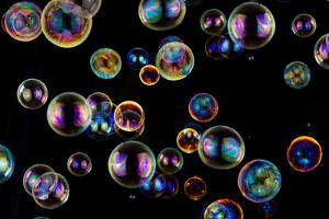 Many Colorful Soap Bubbles on Black by Hanohikirf