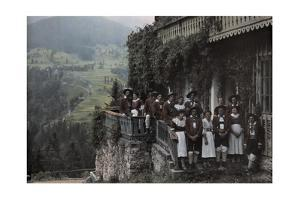 A Large Group of People Stand on a Balcony in Traditional Costume by Hans Hildenbrand