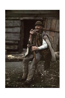 A Man Sits on a Log Holding an Axe and Pipe by Hans Hildenbrand