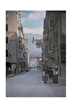 A Photograph of People on the Main Street Through Innsbruck by Hans Hildenbrand