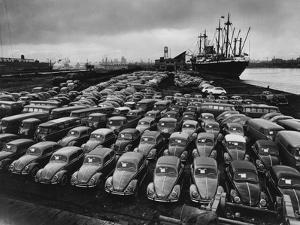 Volkswagen Beetles Lined Up on the Dock by Hans Marx