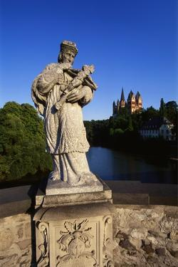 Statue on the Old Lahn-Bridge and a Cathedral in Limburg, Germany by Hans Peter Merten