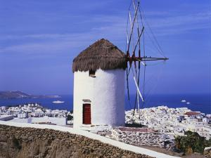 Windmill and View of Mykonos by the Coast, Cyclades, Greece by Hans Peter Merten