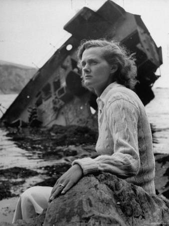 Author Daphine du Maurier Sitting by a Wrecked Ship