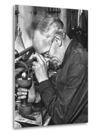 "Diamond Setter Putting Stones into ""Dops"" for the Polishers by Hans Wild"