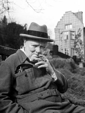 Former Pm Winston Churchill Resting on Bench, Puffing on Cigar, Outside Country Estate Chartwell by Hans Wild