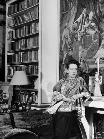 Madam Elsa Schiaparelli Enjoying Her Study Which is Filled with Treasures, Paintings, and Books