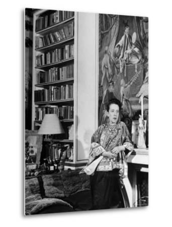 Madam Elsa Schiaparelli Enjoying Her Study Which is Filled with Treasures, Paintings, and Books by Hans Wild