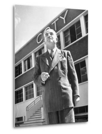 President and Director of Coty Perfumes Andre Lavault in Front of Building Holding Cigarette by Hans Wild
