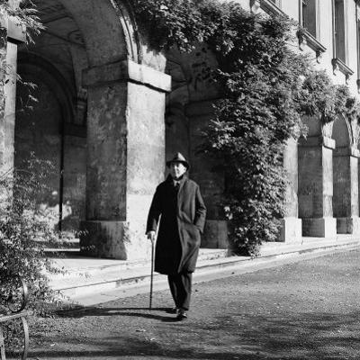 Scholar C.S. Lewis Walking with Cane Near Building at Magdalen College, Oxford University by Hans Wild